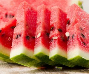 slices of watermelon on wooden table. selective focus